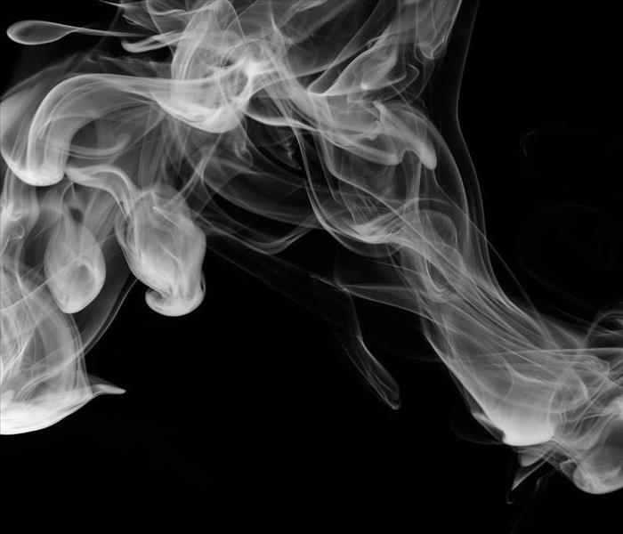 Plume of white smoke on a black background.